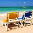 Chairs on sandy tropical beach — Stock Photo #4635590