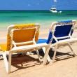 Chairs on sandy tropical beach — Stock Photo