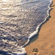 Tropical beach with footprints — Stock Photo