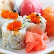 Sushi and california rolls - Stock Photo