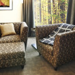Stock Photo: Armchairs with ottoman