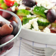Olives and greek salad — Stock Photo