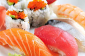 Sushi and california rolls — Stock Photo