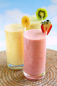 Assorted fruit smoothies — Stock Photo