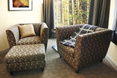Armchairs with ottoman — Stock Photo