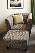 Armchair with ottoman — Stock Photo