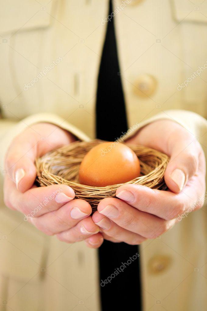 Hands holding nest with egg — Stock Photo © elenathewise ...