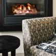 Fireplace and armchair — Stock Photo