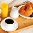 Breakfast on a bed in a hotel room — Stock Photo #4642372