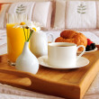 Breakfast on a bed in a hotel room — Stock Photo #4642380