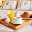 Breakfast on a bed in a hotel room — Stock Photo #4642385