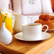 Breakfast on a bed in a hotel room — Stock Photo #4642386