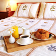 Breakfast on a bed in a hotel room — Stock Photo #4642387