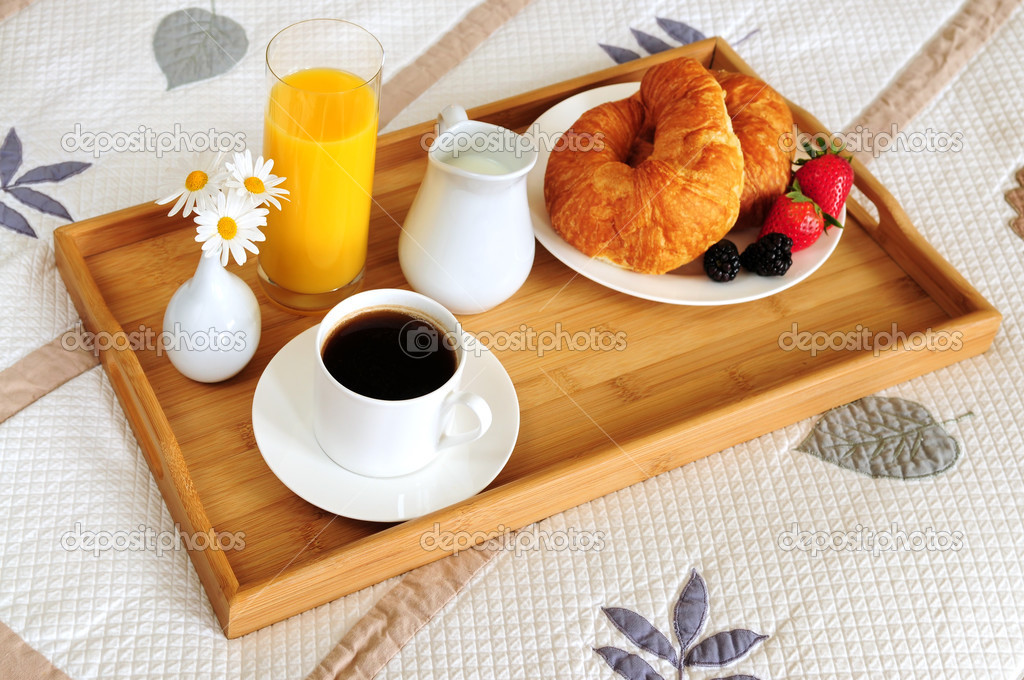 Tray with breakfast on a bed in a hotel room — Stock Photo #4642379