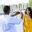 Woman posing for picture near boats — Stock Photo #4718438