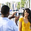 Woman posing for picture near boats — Stock Photo #4718440