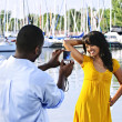 Woman posing for picture near boats — Stock Photo