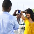 Woman posing for picture near boats — Stock Photo #4718442