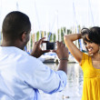 Woman posing for picture near boats — Stock Photo #4718445