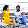 Happy couple sitting at beach — Stock Photo #4718458