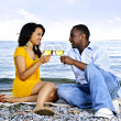 Happy couple having wine on beach — Stock Photo #4718460