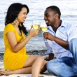 Happy couple having wine on beach — Stock Photo #4718461