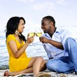 Happy couple having wine on beach — Stock Photo #4718462