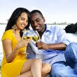 Happy couple having wine on beach — Stock Photo #4718464