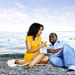 Happy couple having wine on beach — Stock Photo #4718466