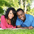 Happy couple in park - Stock Photo
