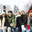 Group of happy friends outside in winter — Stock Photo