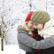 Stock Photo: Two girl friends hugging outside in winter