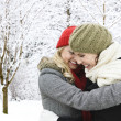 Two girl friends hugging outside in winter — Stock Photo