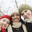 Group of girl friends outside in winter — Stock Photo