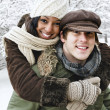Couple having fun outside in winter - Stockfoto