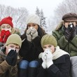 Group of friends with colds outside in winter — Stock Photo #4718573