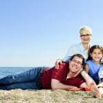 Happy family at beach — Stock Photo #4718601