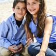 Brother and sister at beach — Stock Photo