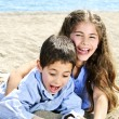 Brother and sister at beach — Stock Photo #4718622