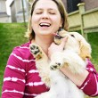 Woman holding puppy — Stock Photo