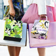 Stock Photo: Women holding shopping bags