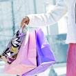 Woman holding shopping bags — Stock Photo #4718667