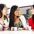 Girlfriends having coffee — Stock Photo