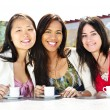 Group of girlfriends having coffee — Stock Photo