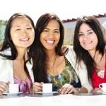 Group of girlfriends having coffee — Stock Photo