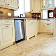Tile floor in modern kitchen — Stock Photo #4718700