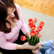 Mother and son with flowers — Stock Photo #4718750