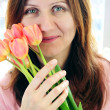 Mature woman with flowers — Stock Photo