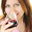 Mature woman with a glass of red wine — Stock Photo