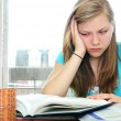 Teenage girl studying with textbooks - Stockfoto